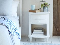 All White side table is a white shabby chic bedside table Painted Side Tables, White Side Tables, Wooden Bedside Table, Bedside Tables, Interior Design Images, Comfy Sofa, Beautiful Houses Interior, Table And Chair Sets, Bedroom Furniture