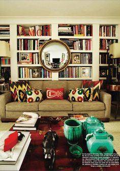 modern eclectic living area/library (source: Nuevo Estilo) LOVE THOSE PILLOWS