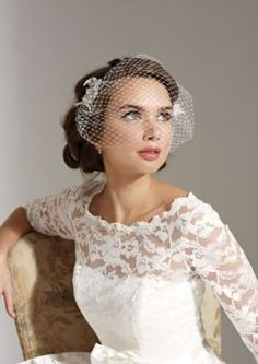 This beautiful bespoke birdcage veil by Joyce Jackson was hand crafted in the UK. The birdcage veil trend goes back to the 1940s/50s. Team the netting with feathers, vintage brooches or clips for a modern twist to a classic look. #passion4hats