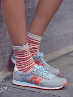 Pair your bold bright New Balance sneakers with striped socks for a classic, yet stylish back to school outfit.