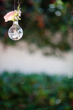 Hanging lightbulb with a small arrangement. Green and super chic. #littleborroweddress