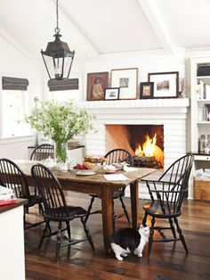 cozy dining space, black chairs, white brick fireplace
