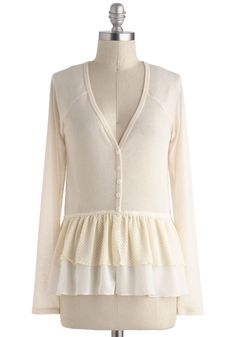 at Mod Cloth // Ivory Fluttering Fabulousness Cardigan - Mid-length, Cream, Solid, Buttons, Work, Peplum, Long Sleeve, Casual