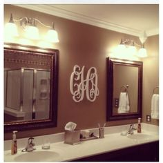 Love for master bathroom!!! Great use of our wooden monogram from wedding decor.