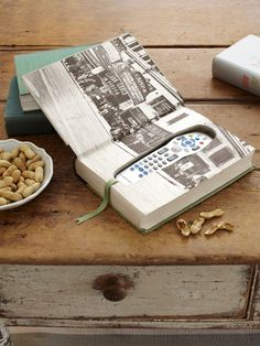 37 Ways to Make Something New Out of Something Old...like this remote control holder in a book!