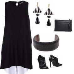 La semplicità di un vestito al ginocchio associata alla particolarità di pendenti con fantasia a righe, stivaletti in pelle in coordinato con borsa e bracciale