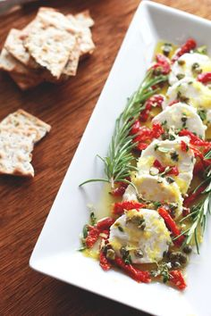 Goat cheese marinated with lemon & herbs.