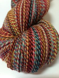 Super fun barberpoling with a riot of color. 4 oz. - 3ply - 410 yds. - fingering/sockweight  dyed by: Nest Fiber Studio colorway: mixed colors,