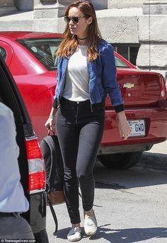 Denin on denim: Brie Larson showed off her stunning figure in a denim bomber jacket over a...