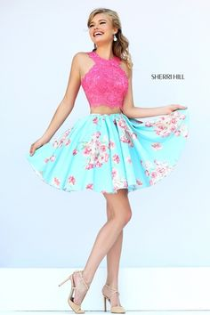"""Sherri HIll #32245 - Lace halter crop top forms a """"T"""" shaped back cutting off at the midriff above a matching floral print A-line mini skirt."""