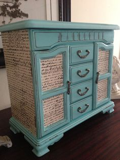 Vintage Jewelry Box Upcycled Hand Painted And Decoupaged In Tiffany Blue. $98.00, via Etsy.