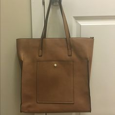 Forever 21 Totebag Barely used, Forever 21 tan/camel totebag. A classic addition for any wardrobe. Forever 21 Bags Totes