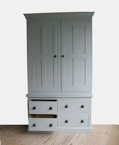 Larder unit with four drawers on soft close runners and two spice racks to inside cupboard doors. Finished with Farrow & Ball and wooden Ebony knobs.