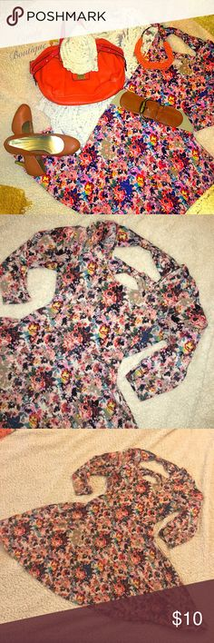 Floral Skater Dress Good pre loved condition! It was one of my favorite dresses. It's a very flattering fit. Has open back with bows across the back!! Size Large. 96% Polyester and 4 % Spandex. Has some piling from previous loving. It's very Comfy. Xhilaration Dresses Mini