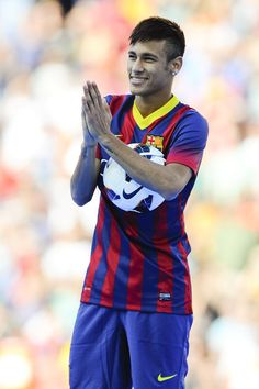 Neymar waves to the crowd during his official presentation as a new player of FC Barcelona.