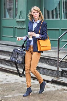Taylor Swift toted her cat while out and about. See more fun style on Wonderwall: http://on-msn.com/1gVt2va