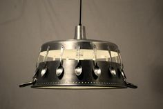 has a nice industrial feeling. Recycled spoons and a kitchen pot pendant light fixture