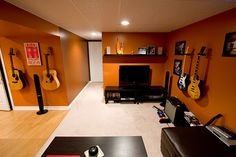basement music room... The color actually is interesting! Of course most of the guitars would be replaced by a baby grand piano...