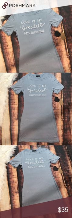 << Love is my Greatest Adventure Tee Shirt Dress > Adorable casual cute tee shirt dress. Really unique blue/gray color. Embroidered wording on front. Very soft stretchy material. Laying flat unstretched the bus measures approximately 17 inches, length measures approximately 33 inches Dresses