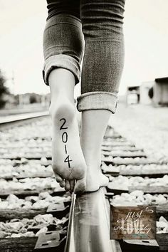 Senior. Cute idea. Love that it's on railroad tracks, too.