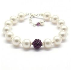 #Mother of #pearl #bracelet with a #gem #centered in the #middle to add a #unique look to a #simple #bracelet.   http://www.ananasa.com/mother-of-pearl-sterling-silver-bracelet.html