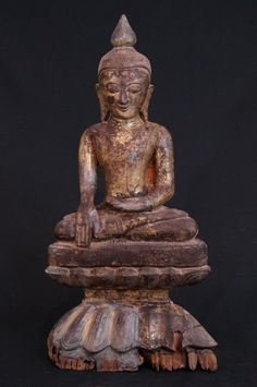Antique wooden Ava Buddha Material: Wood 66 cm high 32,5 cm wide Goldplated with 24 krt. gold Ava style Bhumisparsha Mudra 16th century - early Ava period Originating from Burma