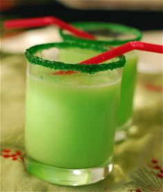 Grinch punch with Sprite and lime sherbet and green sprinkles/sugar rim.