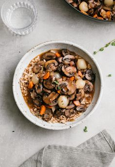 Vegan Mushroom Bourguignon is the ultimate savory mushroom stew that's made in one pot and delicious served over mashed potatoes, cauliflower mash or farro! It's a mushroom lover's delight! Mushroom Bourguignon, Mushroom Stew, Mushroom Recipes, Veggie Recipes, Whole Food Recipes, Vegetarian Recipes, Cooking Recipes, Healthy Recipes, Vegans