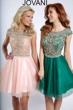 Jovani 94228 fully embellished cap sleeve bodice with a tulle skirt.