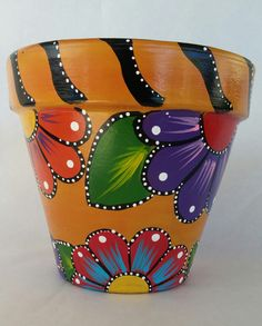 This is a bright, cheery, colorful pot that is sure to bring life to any patio, kitchen, entry way or anywhere you decide to place it. I chose bright orange, red, purple, teal, pink and yellow with accents of black and white. Clay pot measures 7 1/2 × 7 inches Acrylic paint and poly sealed Indoor/ outdoor safe