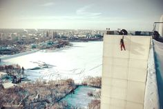 Mustang Wanted is a daredevil athlete from Kiev, Ukraine. On his website he releases heart-stopping photos and videos of himself climbing and hanging off of extremely high surfaces without the use of ropes or safety harnesses.