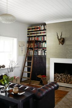 13. A respect for the origins of this 19th-century farmhouse informed the decorating style of the living room. In...