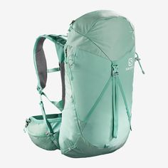 The Salomon Women's Out Night 5 pack is a sleek option for female fastpackers and overnight adventurers. It draws from Salomon's heritage in building torso-fitting running packs but incorporates hike-oriented features and performance. Camping, Backpacking, Salomon Running, The North Face, Backpack Online, 5 W, Turquoise, Drawstring Backpack, Bucket Bag