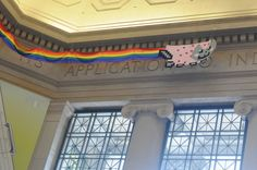 A Nyan Cat appeared in MIT's Lobby 7 early in the 2011 academic year to welcome the undergraduates.  This popular internet meme is a flying cat with a Pot-Tart body that leaves behind a rainbow trail.