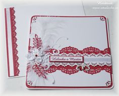Big red wedding card with embossed paper and satin flower.