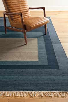 Inspired by Bauhaus design, this flat-weave patterned rug anchors your room with a strong, graphic statement.