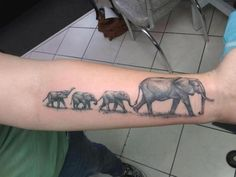 Elephant family by John Embry at Tattoo Charlies