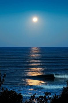 Moon reflection on blue water