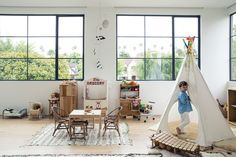 The kid's room is every child's dream room complete with a teepee for sleepovers, miniature wishbone chairs for homework, and large windows to let light in for extended hours of play time.
