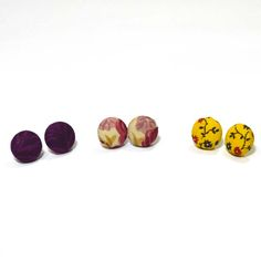 Fabric Earrings (3 pair), $25. Three is never a crowd with these adorable studs! Featured in this three pack are a set of burgundy-magenta, yellow and mauve, and floral fabric studs. Handmade from reclaimed fabric.