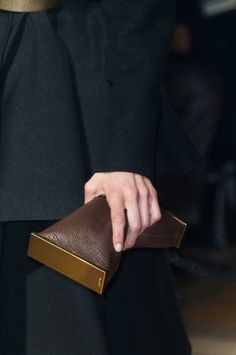 Indulge in a chocolatey leather clutch to spruce up your evening-out look. | Lincoln Black Label