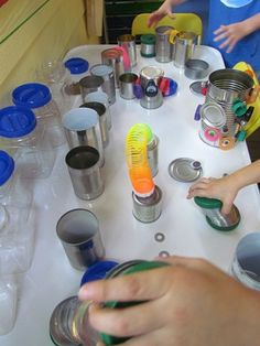 tin can magnet play - Magnets are affixed to various recyclables and toys. Magnetic items can be stuck to empty cans or magnetic boards.