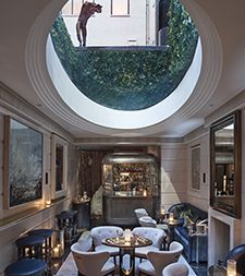 Room Features Limestone Walls And An Oval Skylight Work Of Architect Tadao Ando Interior Design By Guy Oliver Home Style Magazine May June 2015