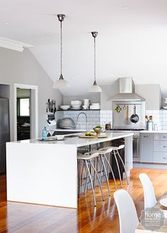 This stylish renovated kitchen features grey and white tones inspired the rest of the home.