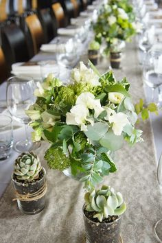 Love these centerpieces and the general look of the table. Don't like whatever those smaller potted cabbage-like things are.