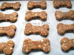 Homemade dog treats with applesauce or bananas, peanut butter, oats, flour, egg
