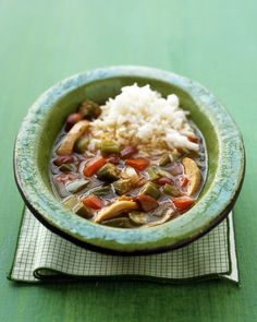Chicken Gumbo - Martha Stewart Recipes    1 tablespoon olive oil  1 pound boneless, skinless chicken thighs  Coarse salt and ground pepper  6 ounces andouille or smoked sausage, halved lengthwise and cut into 1/4-inch pieces  1 medium onion, diced  1 medium green bell pepper, ribs and seeds removed, diced  1 tablespoon tomato paste  2 teaspoons dried thyme  1 pound okra, cut into 1/2-inch-thick rounds  2 vine-ripened tomatoes, diced  2 tablespoons all-purpose flour