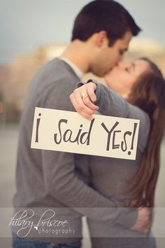 "Cute! Engagement / save the date wedding announcement photo with ""I said yes"" sign"