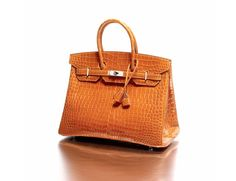 "Hermès Paris made in France Sac ""Birkin"" 35 cm en crocodile porosus brillant orange"