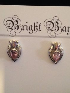 Majestic BB Bright Bay .925 Silver Pink CR Opal Inlay with Tear Drop Pink Cubic Zirconia Post Earrings. These earring are very Majestic in appearance and absolutely Beautiful. Florida residents pay 7% sales tax.